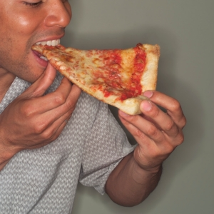 Person eating pizza