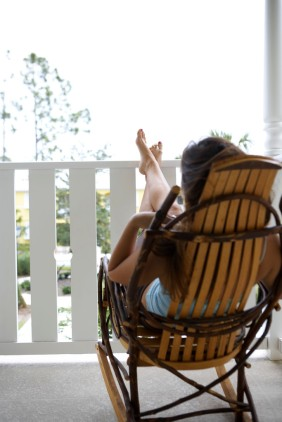 Woman Relaxing in Rocking Chair
