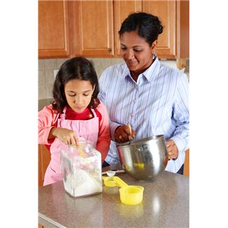 Woman and child measuring ingredients