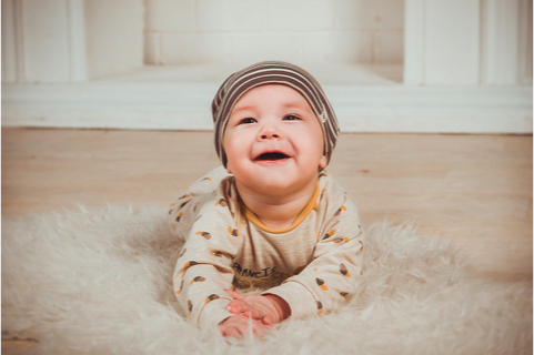 Young baby on rug