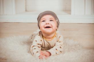 Young baby on rug