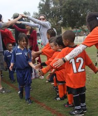 Photo of children sport teams handshaking after a sports game.