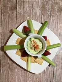 hummus plate with celery sticks and crackers