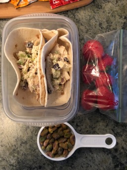 chicken salad wraps with pre-portioned strawberries and pistachios