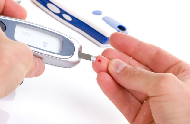 picture of finger stick blood sugar test