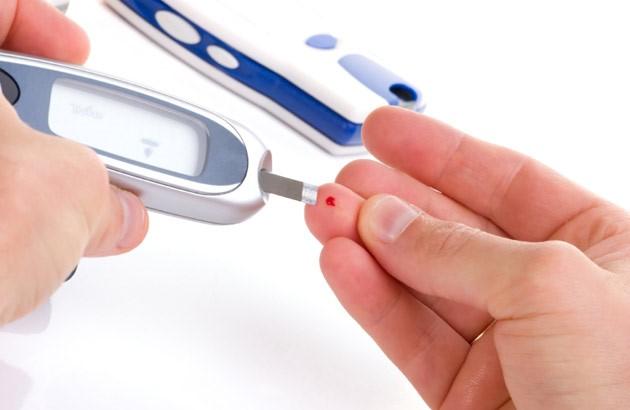 picture of finger stick blood sugar test