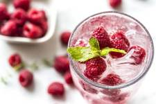 water with raspberries