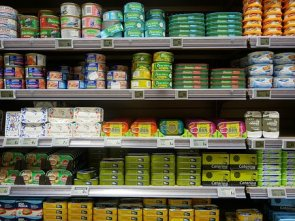 pictures of canned foods on grocery store shelves