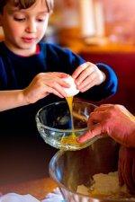 child cracking an egg