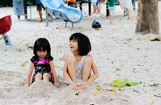 Picture of two girls playing in the sand