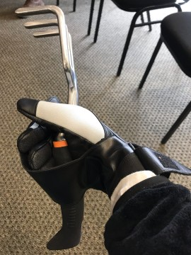 garden gloves with velcro , holding a garden hand tool