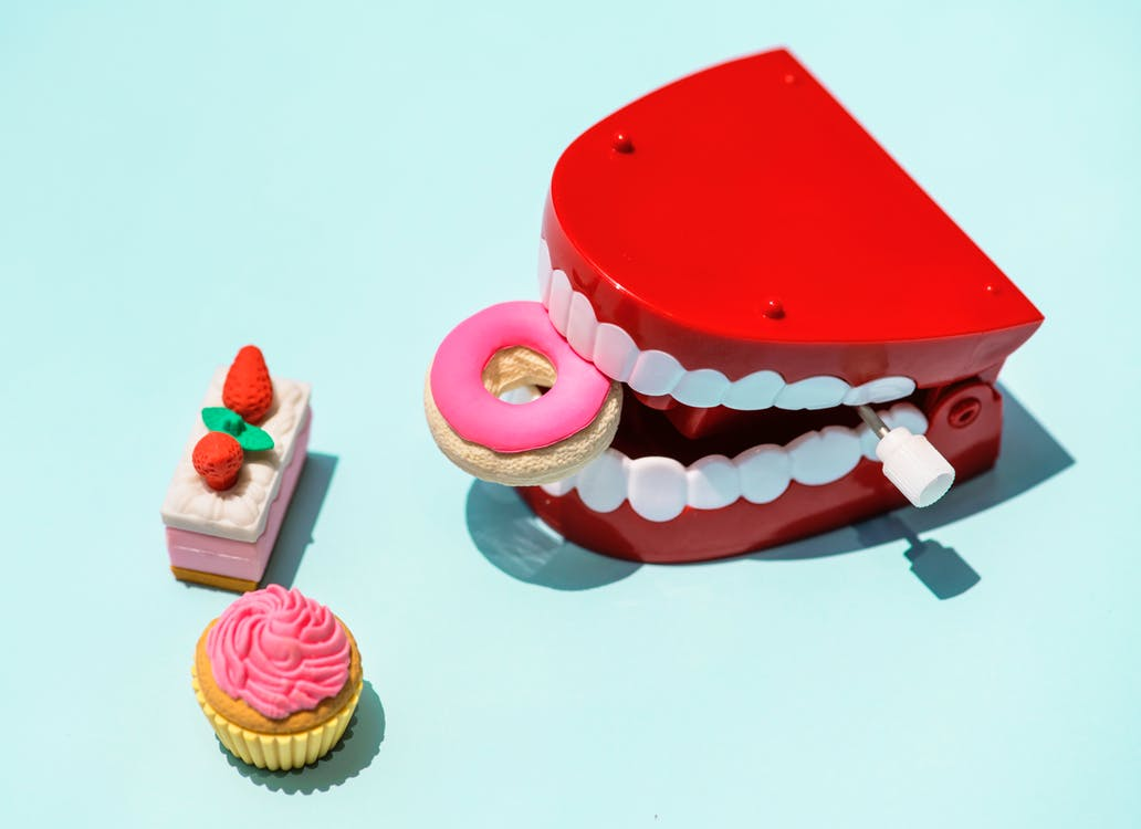 Picture of toy teeth eating candy