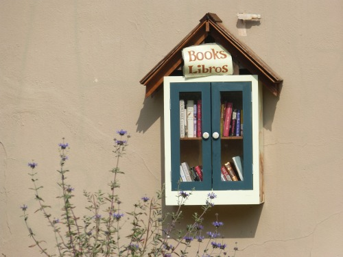 Birdhouse shaped book exchange cabinet