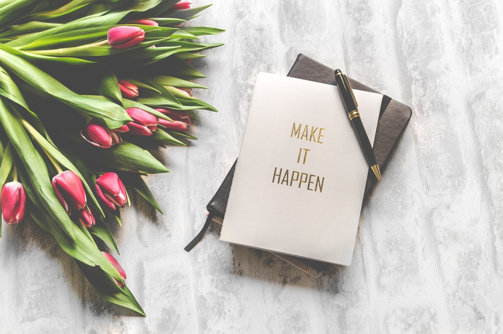 "picture of journal with note ""Make it Happen"""