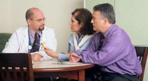 Couple talking to doctor about diabetes