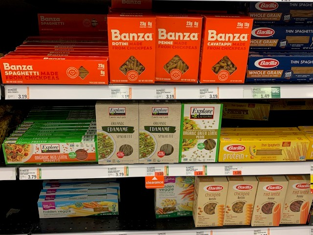 boxes on grocery shelf of chickpea, edamame and lentil pasta