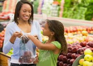 Mother and daughter shopping for fruit.