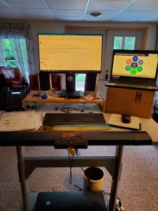 standing desk with raised monitor