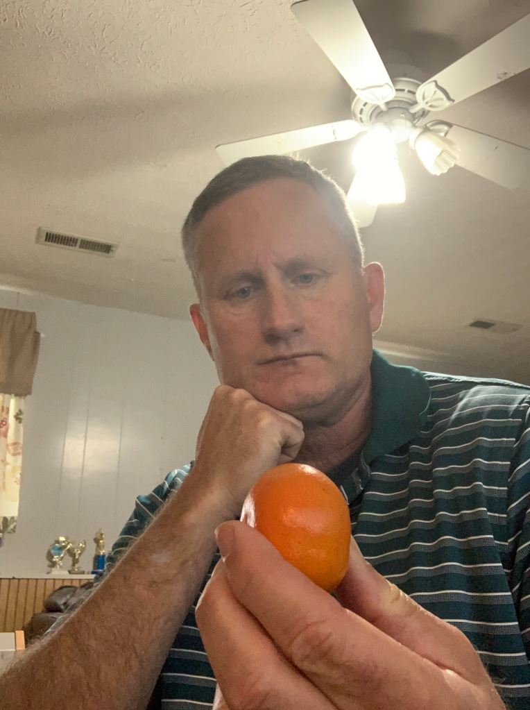 Man thinking about a tangerine
