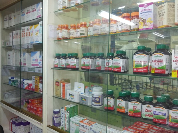 a cabinet full of dietary supplements